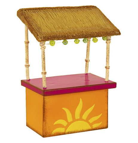 Mini magenta & orange tiki hut that has a yellow half sun on it. Its got an overhang with lights on it being held up with four bamboo poles.