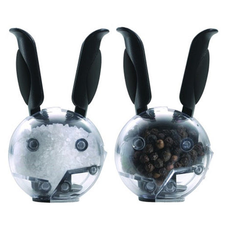These are miniature magnetic grinders with long grip handles that look like rabbit ears. One contains white salt, while the other contains brown pepper.