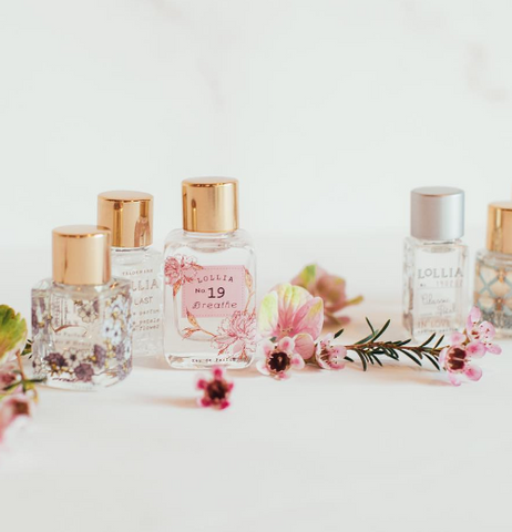 many kinds of small perfumes like perfume At Last. lolia #19 Breathe. lolia Relax perfume. lolia in love perfume sitting in a white background.
