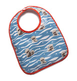 This image shows bibs with designs, with red outline around the bibs. has a design of blue water that fills  the bottom half of the bib and the top half shows two  otters with their bodies inside the water,  but with their heads sticking out of the water.