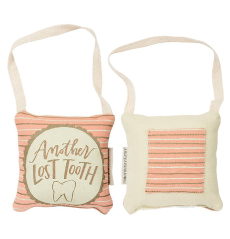"This pink pillow is white with gold and blue stripes with ""Another lost tooth"" written on it. it has a pocket to hold tooth and handle to hang off bed knob or door."