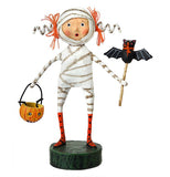 A mummy girl holding a bat wand while carrying a jack-o-lantern treat bucket