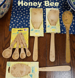 "The Solid Beechwood ""Honey Bee"" utensils has the display of tools for the kitchen."