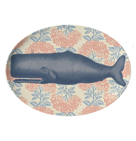 Large tray with a whale with a background of plants.