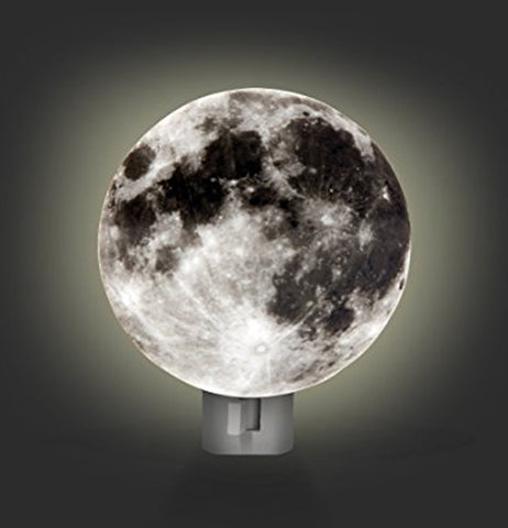 The moon shaped nightlight in the on position showing the glow