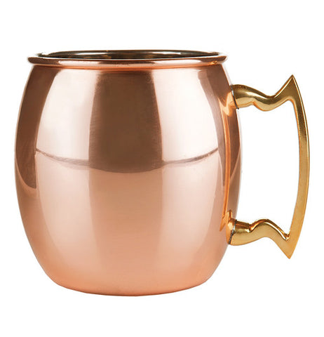 Mug that is copper and has a handle that is a cool shape.