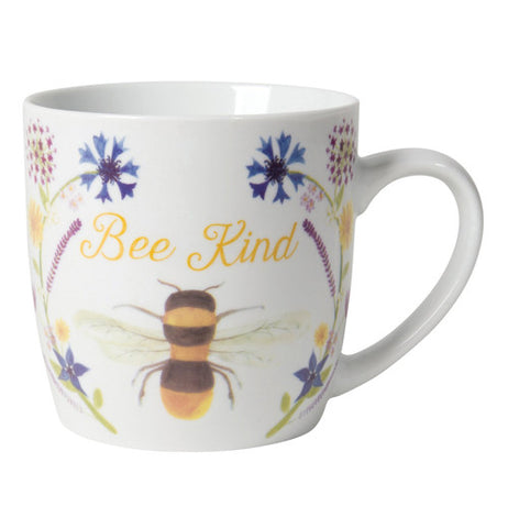 "The white mug says ""Bee Kind."" The cup has a large bubble bee and 2 blue flowers."