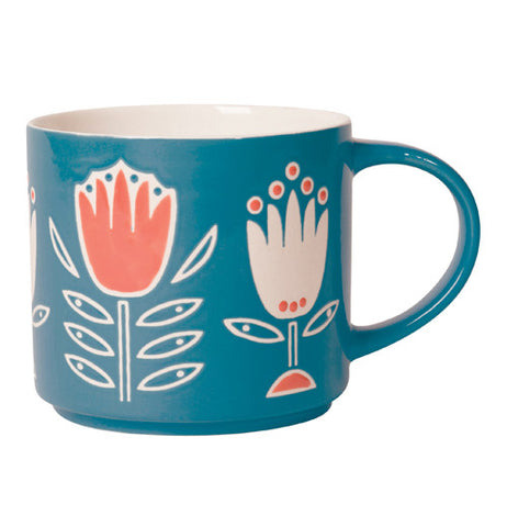 The mug is blue with orange and white tulips around it.