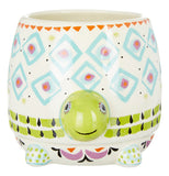turtle shaped mug with diamond pattern. painted in green, blue, red, black and pink