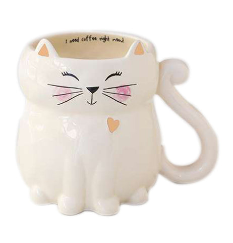 "Cat shaped mug with a tail handle, an orange heart, pink cheeks, and smiling face. Inside there is a message that says ""I need coffee right meow""."