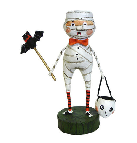 The Mummy Boy wrapped in white tape with red bow holds a ghost candy on one hand and a bat wand on the other.