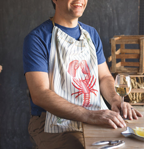 A man is seen wearing the black-striped white bib with a red lobster on its front.
