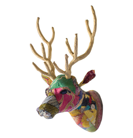 """Kantha Covered Reindeer Head"" wall mount with multi-colored covering and yellow antlers over a white background."