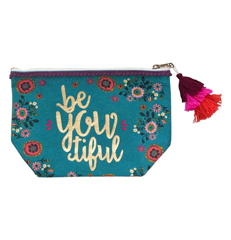 "A turquoise pouch with floral designs and text that reads ""beYOUtiful"" in gold lettering and a zipper on top with a red, pink, and purple tassel."
