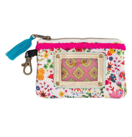 The white id pouch has a floral design all over with a clear window in the center for displaying an ID and zipper with a blue tassel on the top.