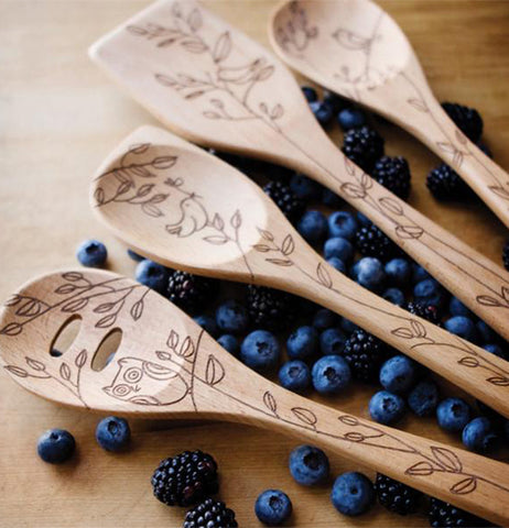There are Four Different Slotted Spoons that have etched pictures of tree leaves on these slotted Spoons.
