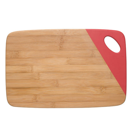 Wooden rectangular cutting board with a red dipped edge on the upper right side where a hole thats used as a handle is.