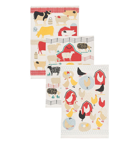 Three dishtowels with simple representations of farm animals, barns, and fences.
