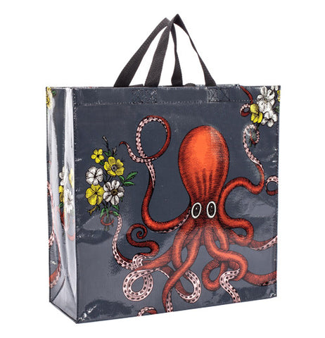 Black shopper bag with a red octopus holding yellow and white flowers.