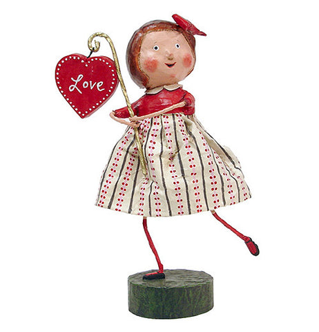 Girl in Red and White Dress holding Heart Sign
