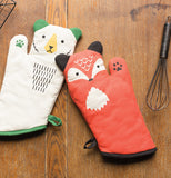 A reddish-orange fox shaped oven mitt with black ears and a white fur chest patch