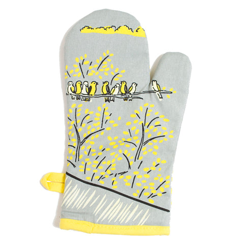 This image shows the back of the Oven Mitt with nine birds on a trees with yellow leaves.