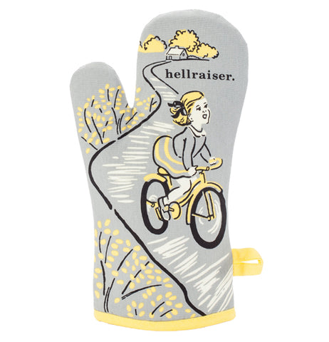 "This Oven Mitt is a gray with yellow, has a yellow haired girl riding a yellow bike, and with yellow trees designs with black text that says, ""Hellraiser""."