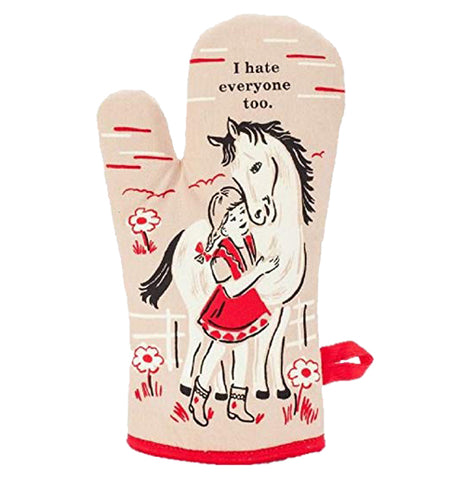 "This oven mitt has a tan color with a girl in a red dress hugging a white horse with black text above that saying, ""I Hate Everyone Too""."