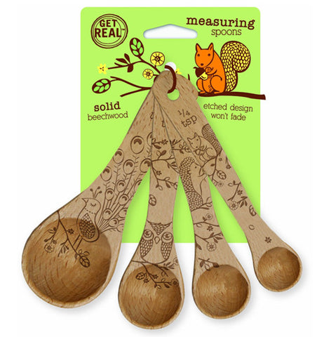 This set of measuring spoons feature their own designs of squirrels, owls, hedgehogs, and peacocks. They are shown attached to their green cardboard packaging, which has an orange image of a squirrel chewing on an acorn.
