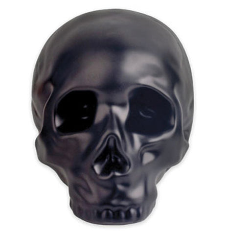 Black stoneware coin bank in the shape of a skull.