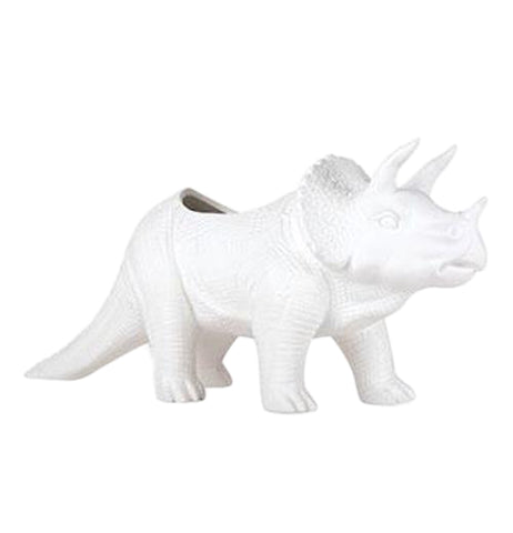 A white porcelain Triceratops planter. It is shaped like a Triceratops dinosaur.