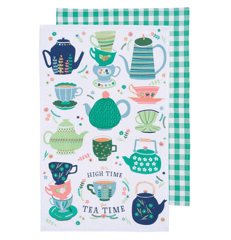 A tea towel with different sized and shaped tea kettles and cups, that have patterns ranging from blue and green stripes to flowers with a plaid green tea towel behind it.