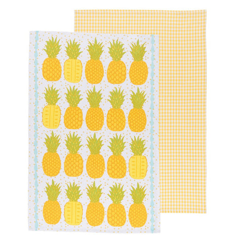 tropical colored Pineapples on one towel and a yellow plaid design on the other.