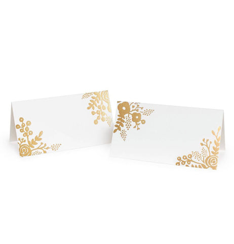 Set of 2 white place cards with a floral pattern on each corners.