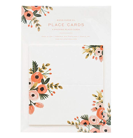 Placecard with flowers in the middle and corners still displayed in packaging.