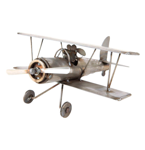 The metal biplane sculpture with the dog pilot is shown from an opposite angle.