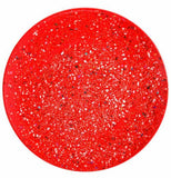 This bright red dinner plate has a black and white polka dot confetti design to it.