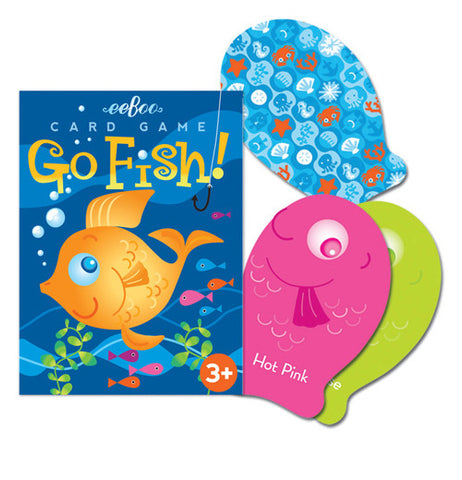 The packaging for the game with its picture of a gold fish has three fish shaped cards to the right of it one is pink, one green, and the last blue with ocean shapes on it