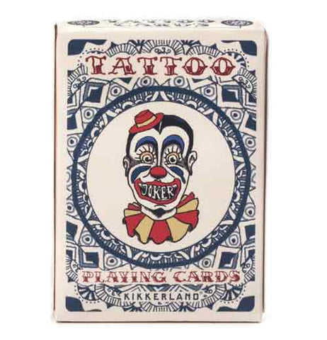 "Front of the box of ""Tattoo"" playing cards with blue, red, and yellow circus clown head with red words that read ""Tattoo Playing Cards"" surrounded by a blue circle and diamond design."