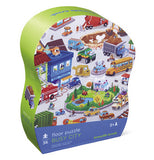 "The ""Busy City"" Puzzle with 36 pieces are packaged in a shapen green and purple box. d"