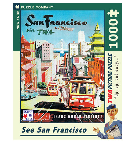 "The front of the puzzle box is shown with the image of a tour guide gesturing to a busy street in San Francisco with an airplane flying over. At the top of the image are the words, ""San Francisco via TWA"" in black and green lettering."