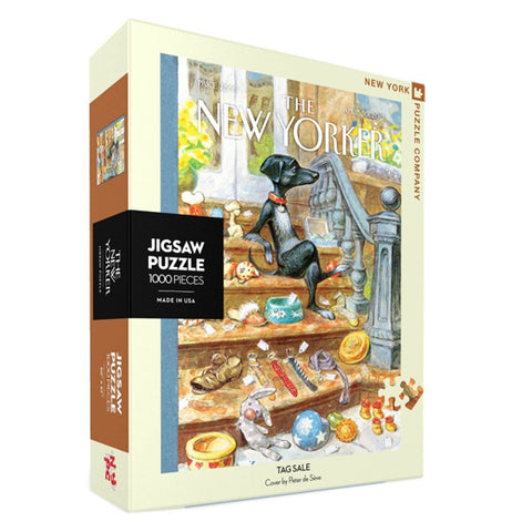 "A box containing a 1000 piece jigsaw puzzle is shown with a picture of a black dog with food and random items strewn around a room. The words, ""The New Yorker"" are shown above the image in white lettering."