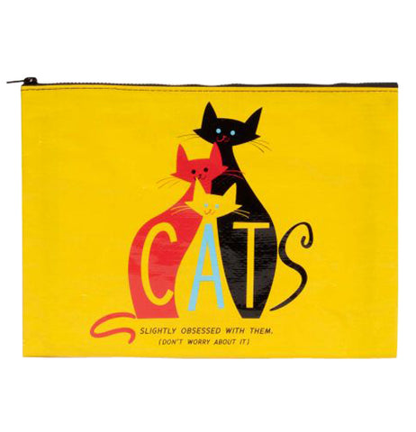 "This yellow zipper pouch shows a red cat, a yellow cat and a black cat with the word CATS incorporated into the cats and text at the bottom that says ""Slightly Obsessed with Them (Don't Worry About It)"""