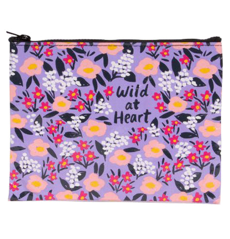 "This zipper pouch has a floral pattern with red and white flowers and black text in the center that reads ""Wild at Heart"""
