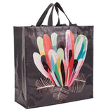Black bag with a multi-colored lotus shaped flower.  It has three black and white leaves at the bottom.