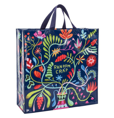 "This shopping bag has a dark purple background with colorful flowers around the green small message that says ""Random Crap""."