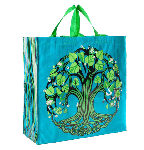 "The ""Tree of Life"" Shopper bag shows illustration of a green tree on a blue background."