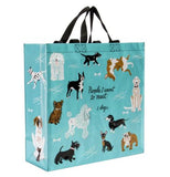 "The ""People to Meet: Dogs"" Shopper Tote Bag has the images of different dogs on a light blue background  with the message that says, ""People I Want to Meet: 1. Dogs""."