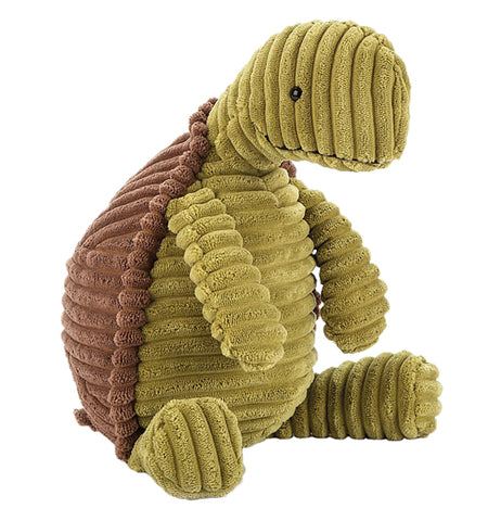 A stuffed green tortoise with a brown shell in a sitting position