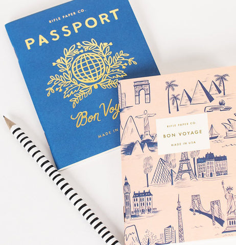 This passport with different of traveling locations, peach colored cover with an pen black and white strips.